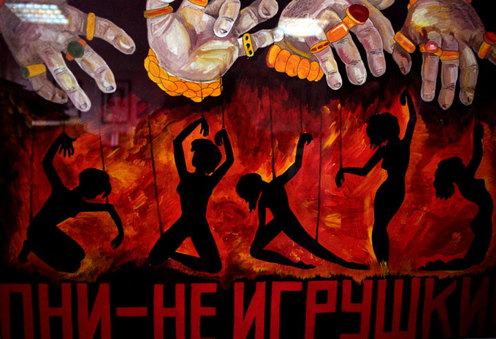 'The Price of Sex' Series, Photograph, 16 x 20 inches, ('They are not puppets,' reads an awareness poster made by high school students. Moldova 2004.), $700