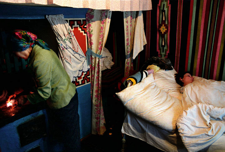 'The Price of Sex' Series, Photograph, 16 x 20 inches, (Olesea sleeps while her mom, Maria, prepares breakfast at six in the morning. During the winter months they share this one room to keep each other warm... Moldova 2004), $700