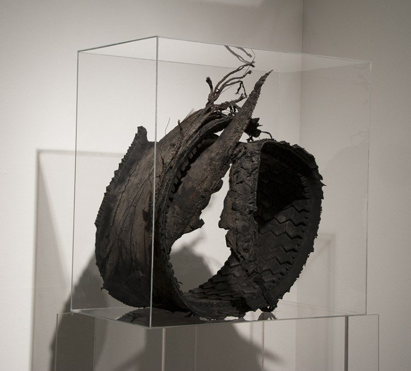 Joyce Westrop (Ottawa, Canada), Remnants of an Age, 2008, Tire remnant, plexiglas and wire, 24 x 24.25 x 13.5 inches. (Front View). $2200.
