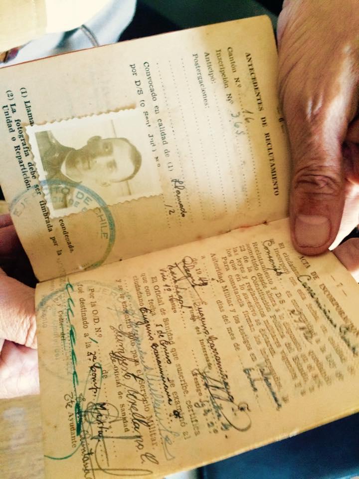 Former political prisoner Eugenio Carramiñana demonstrates his past identification papers