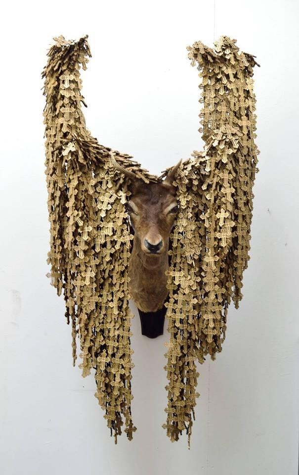 Rowan Corkill (London, England),  The Seeker 2014-2016. Taxidermy Deer Head, Wooden Rosary Crosses, Black Beads, Rope, Fabric, Metal. Commissioned Artwork.