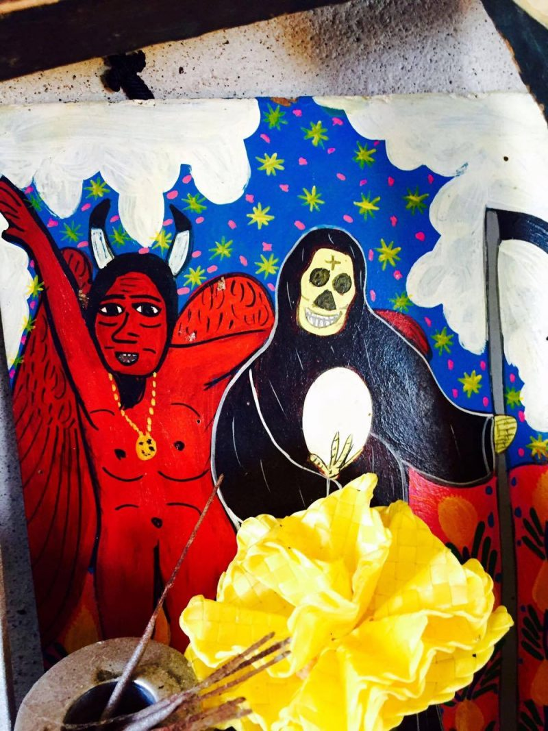 Vintage painting depicting Death & The Devil, unknown artist. 'All Saints' Shrine Installation by LPM Projects along with local participants. Commissioned for the Day of the Dead Celebrations in Puerto Vallarta, Mexico.